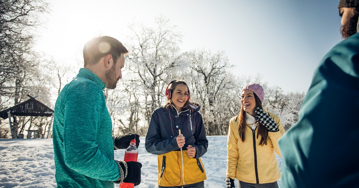 friends working out together cold weather - winter fitness regimen