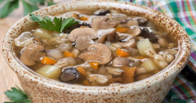 mushroom soup with pearl barley, close-up, horizontal