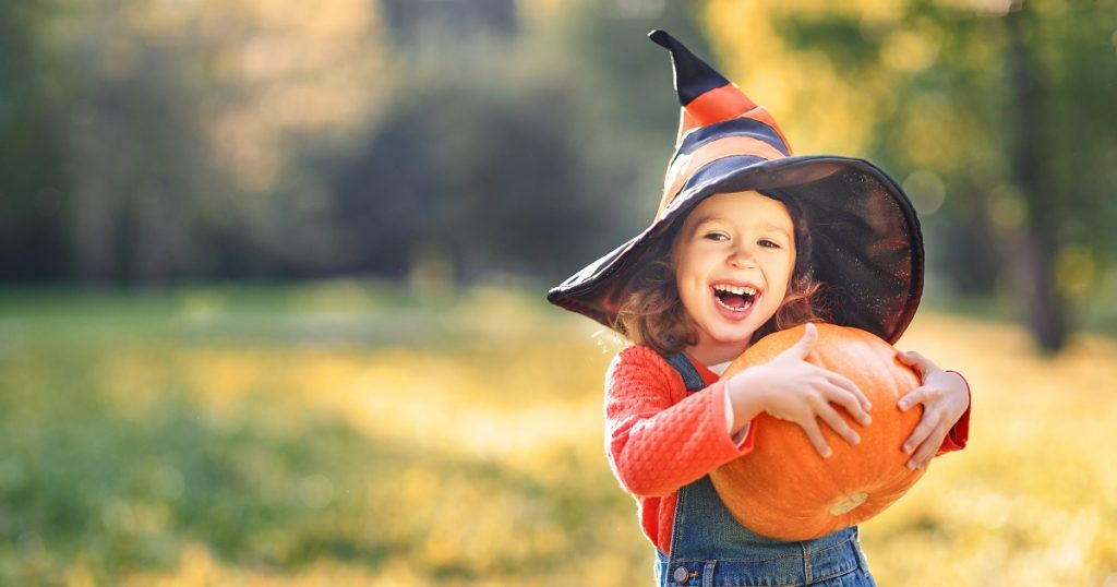 halloween and asthma - little girl with pumpkin
