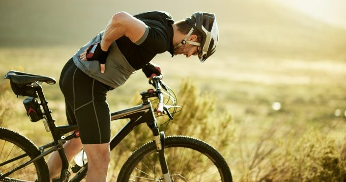 overuse injury, man riding bike