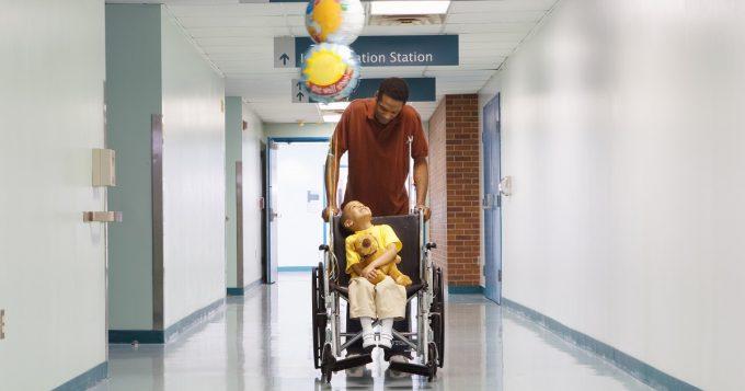 little boy in wheelchair at hospital