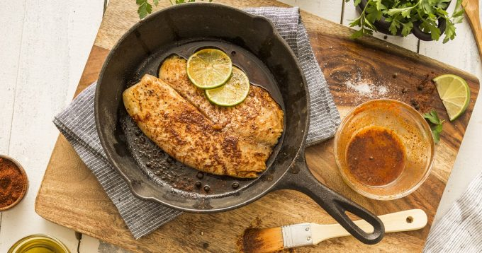 Tilapia on frying pan