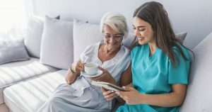 woman reading book with caregiver