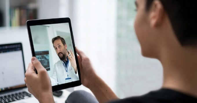woman using telehealth