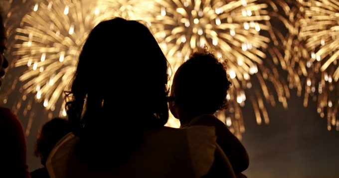 Mom and child watching fireworks