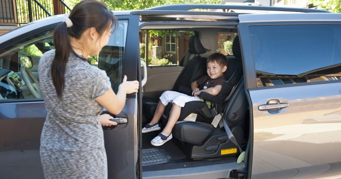 Mom and boy in minivan