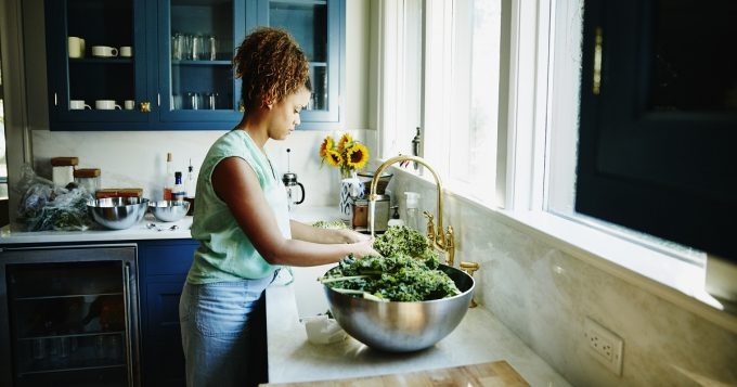 Woman washing kale