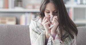 Woman with flu symptoms